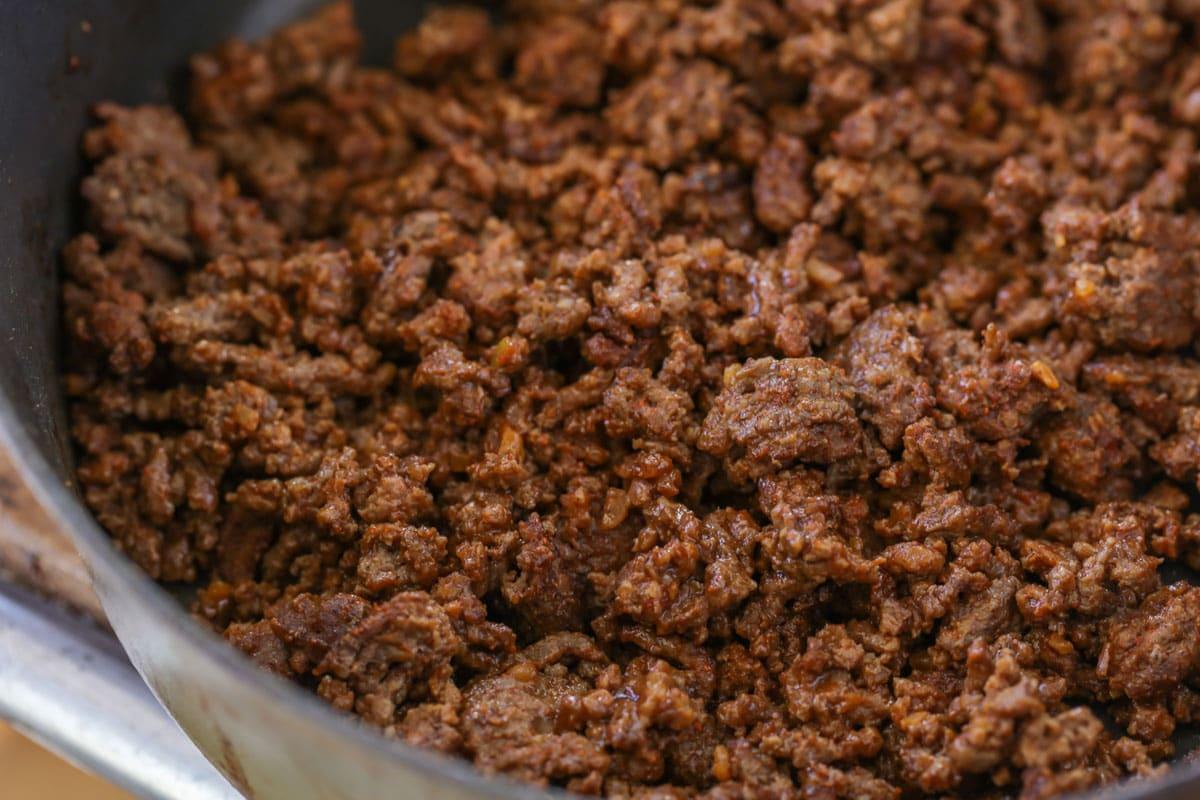 Taco seasoned ground beef in a skillet