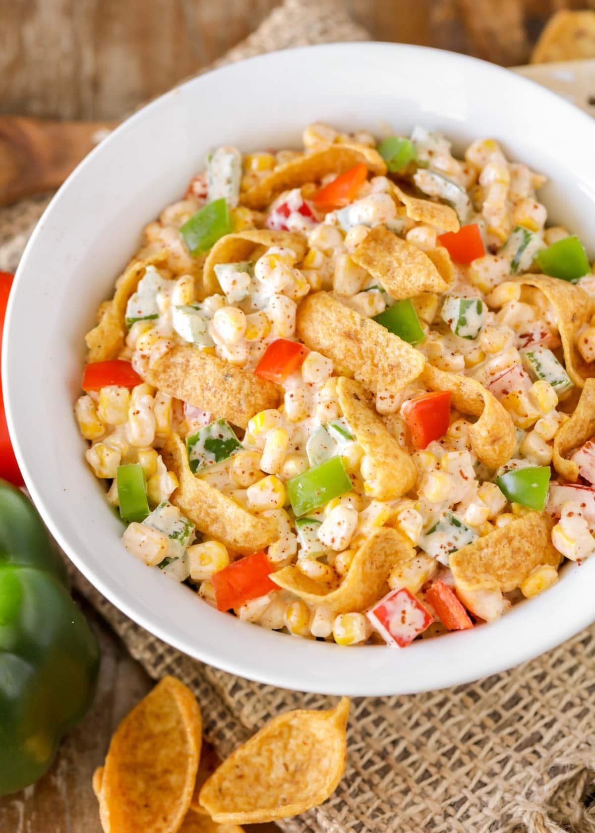 close up of frito corn salad in a white bowl
