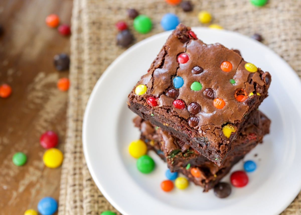 M&M Brownies stacked on a white plate
