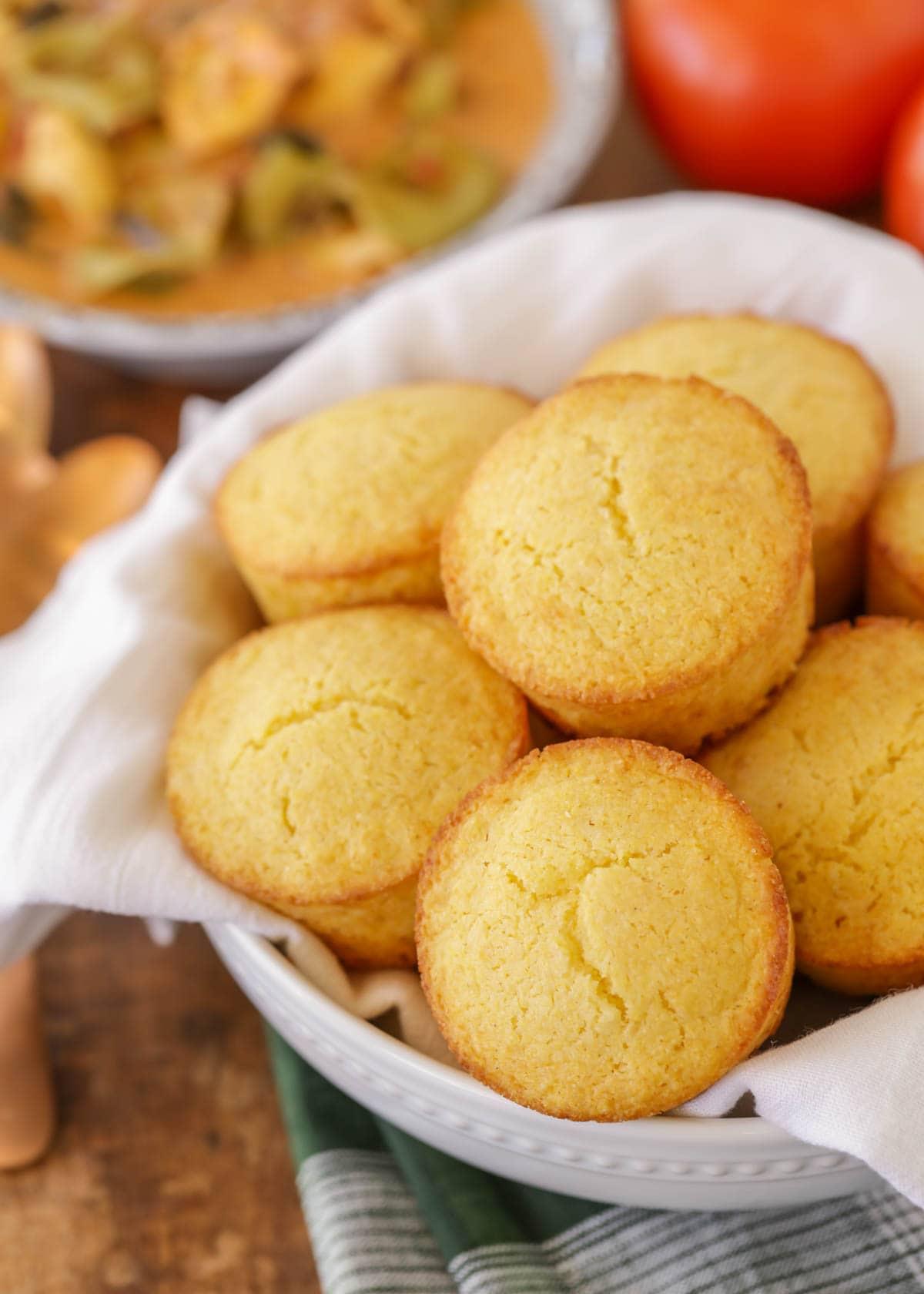 Honey cornbread muffins in a white bowl