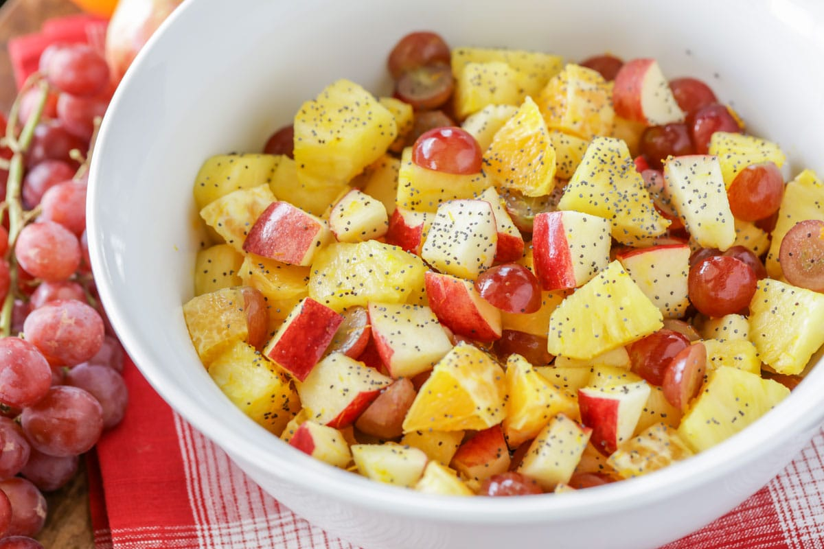 fall fruit salad chopped and dressed in a white bowl