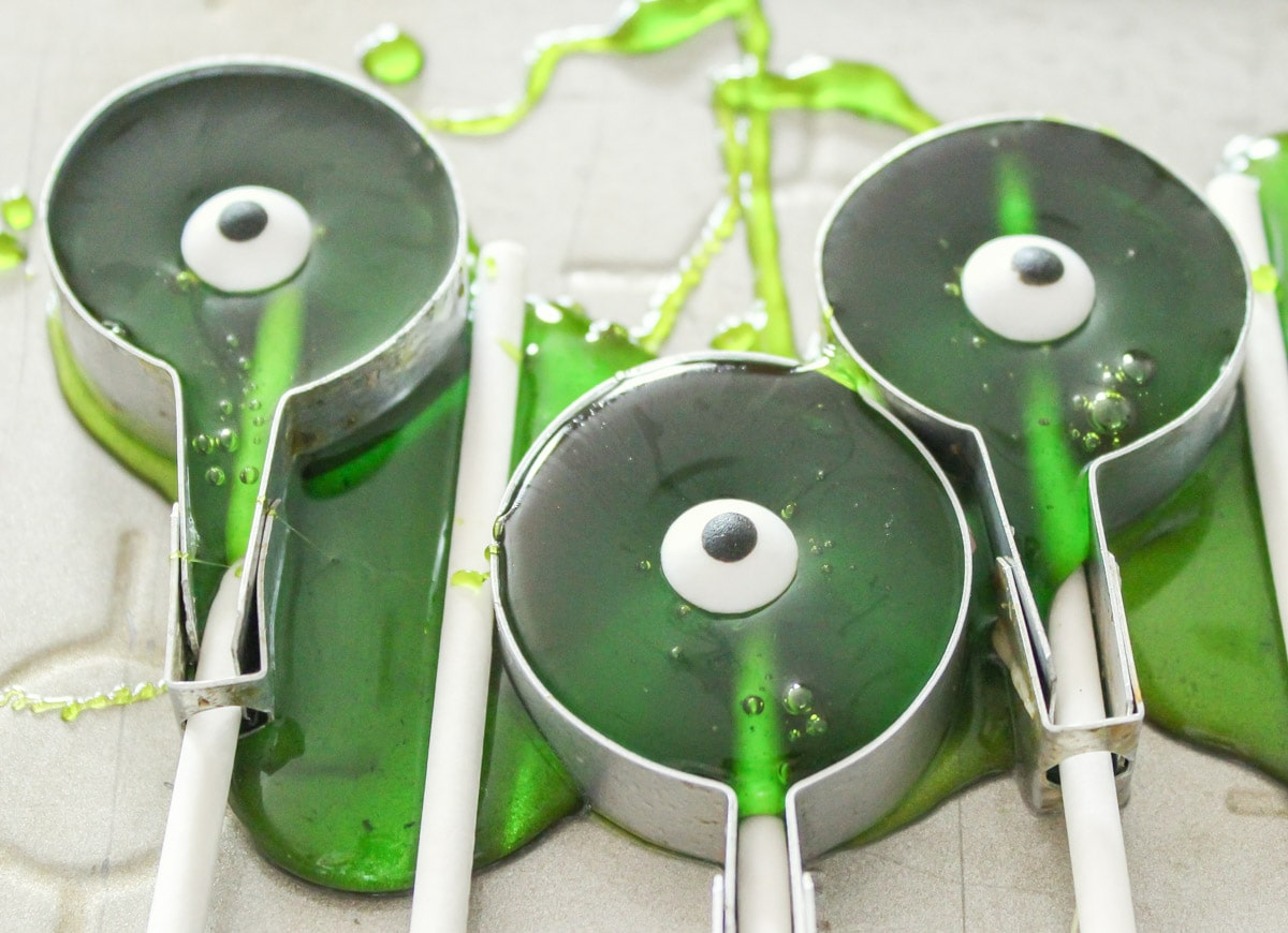 Green candy poured into sucker molds