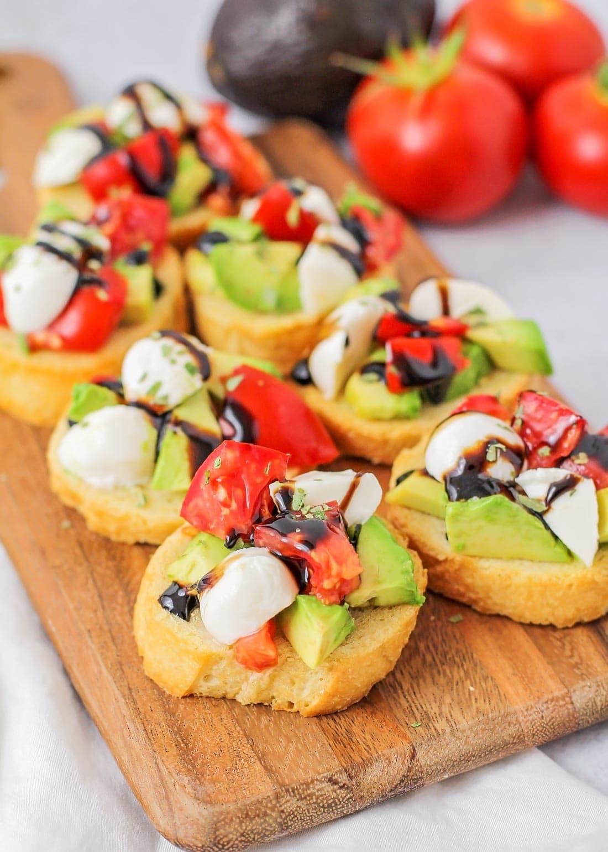 Caprese salad bruschetta drizzled with balsamic glaze
