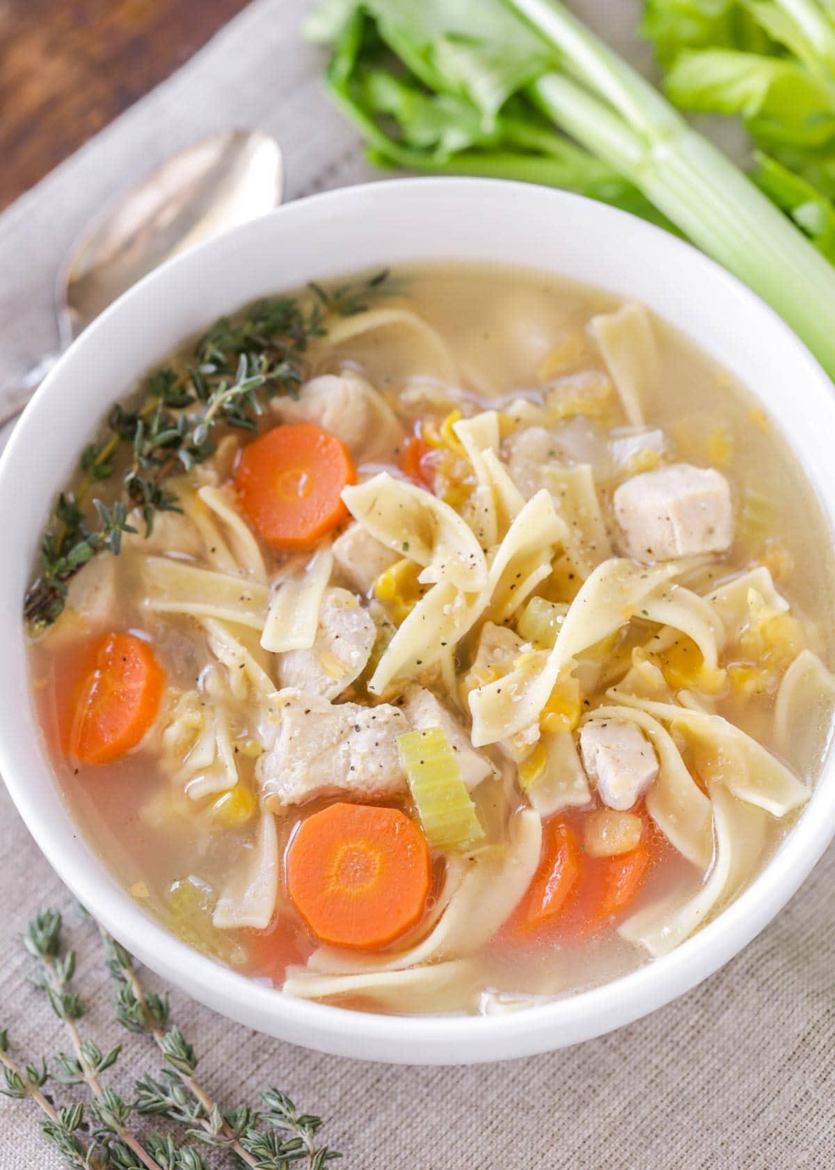 white bowl of chicken corn soup
