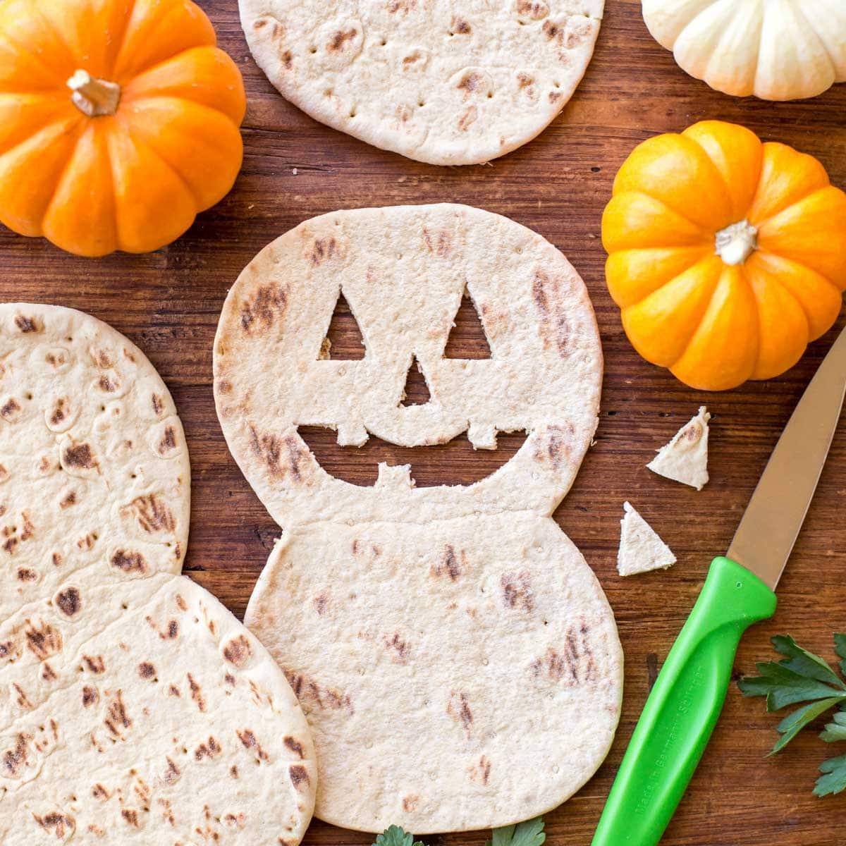 flat out bread cut into jack o lantern shapes