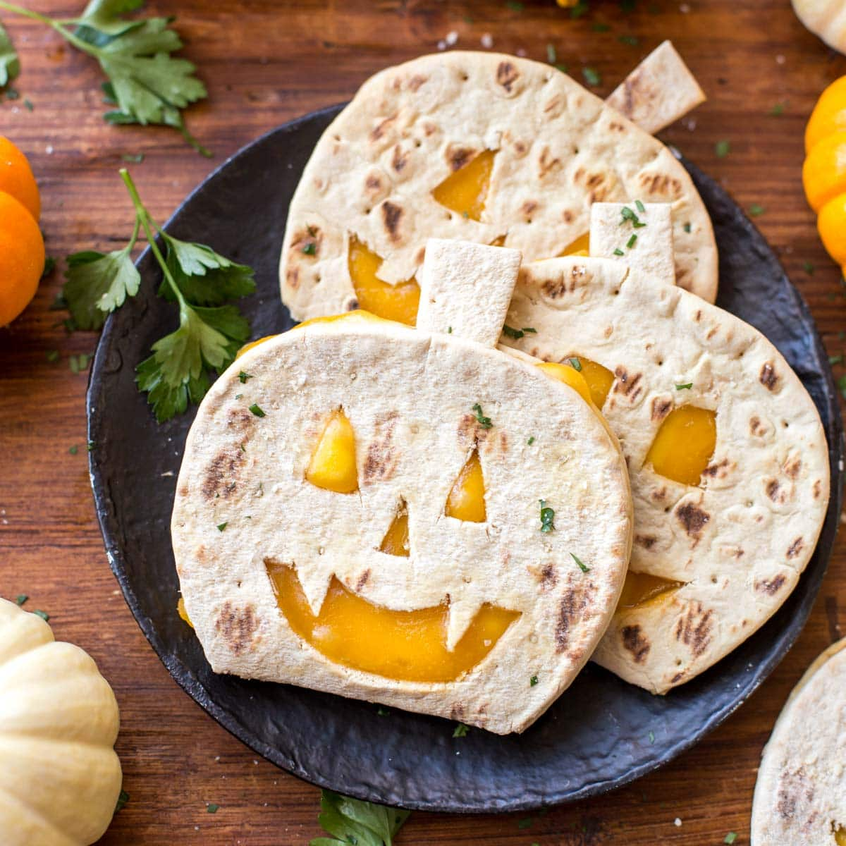 Pumpkin quesadillas shaped like pumpkins