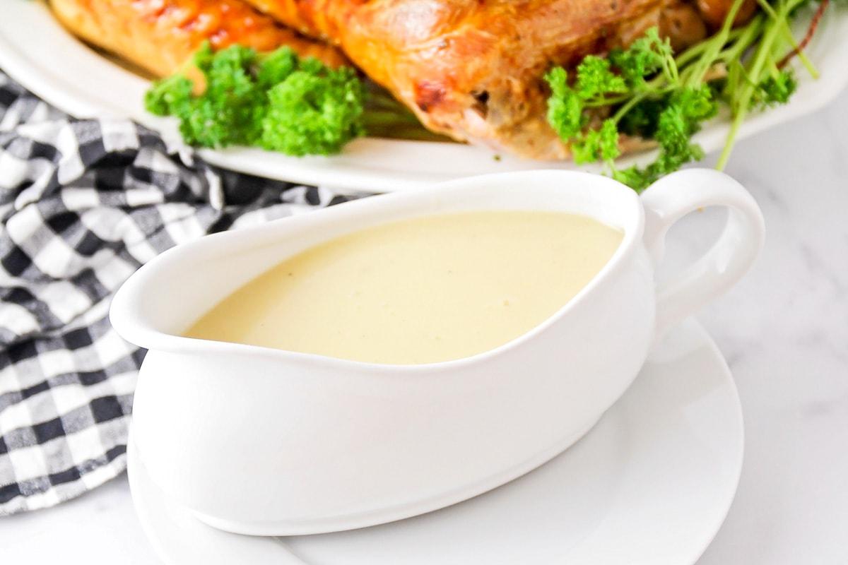 Turkey gravy with drippings in a gravy boat