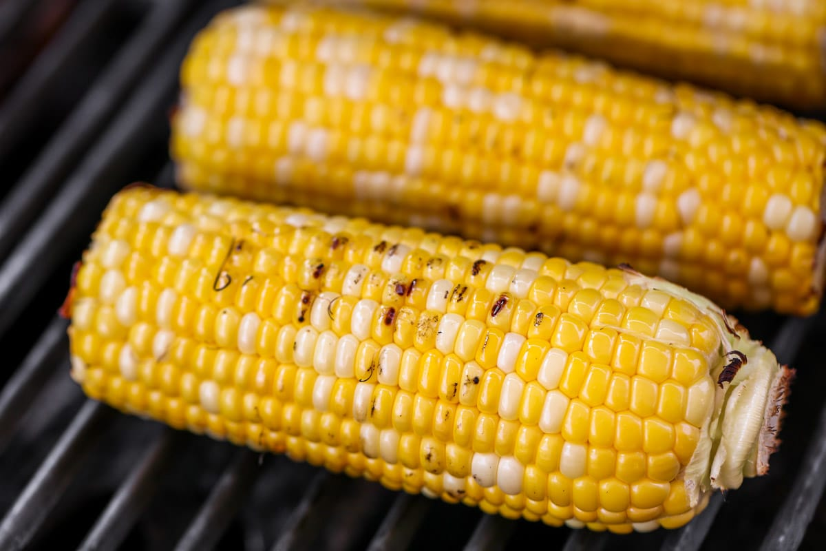 Grilled corn cooking on the grill